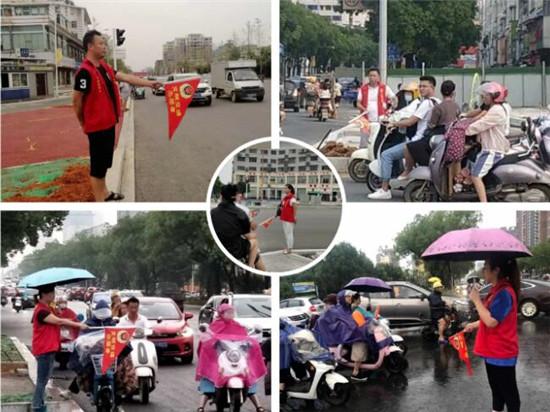 团市委书记徐新颖带领干部职工站好交通志愿岗